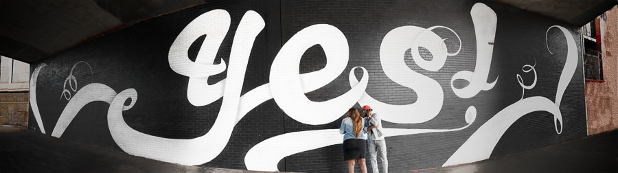 Jade and Christopher after the proposal at the Yes Wall in Dumbo Brooklyn, New York.