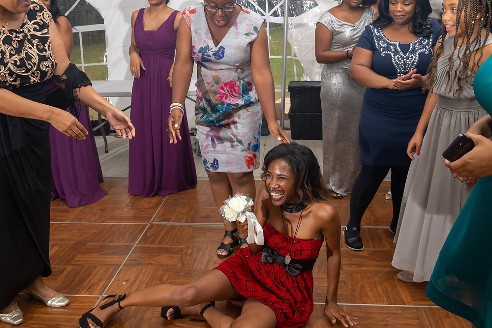 The wedding guest made a dive for the bouquet during the bouquet toss at the wedding reception in Fairfax, Virginia.