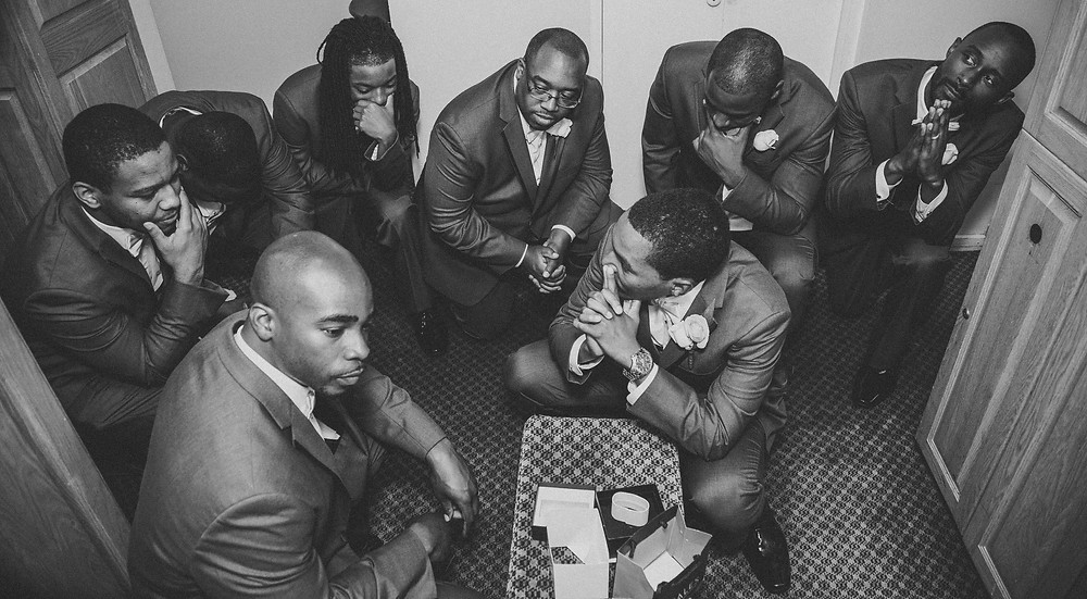 Adonis and his groomsmen getting ready for the Moore Wedding in Richmond, VA.