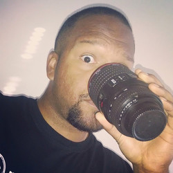 Shane sips from his replica lens cup