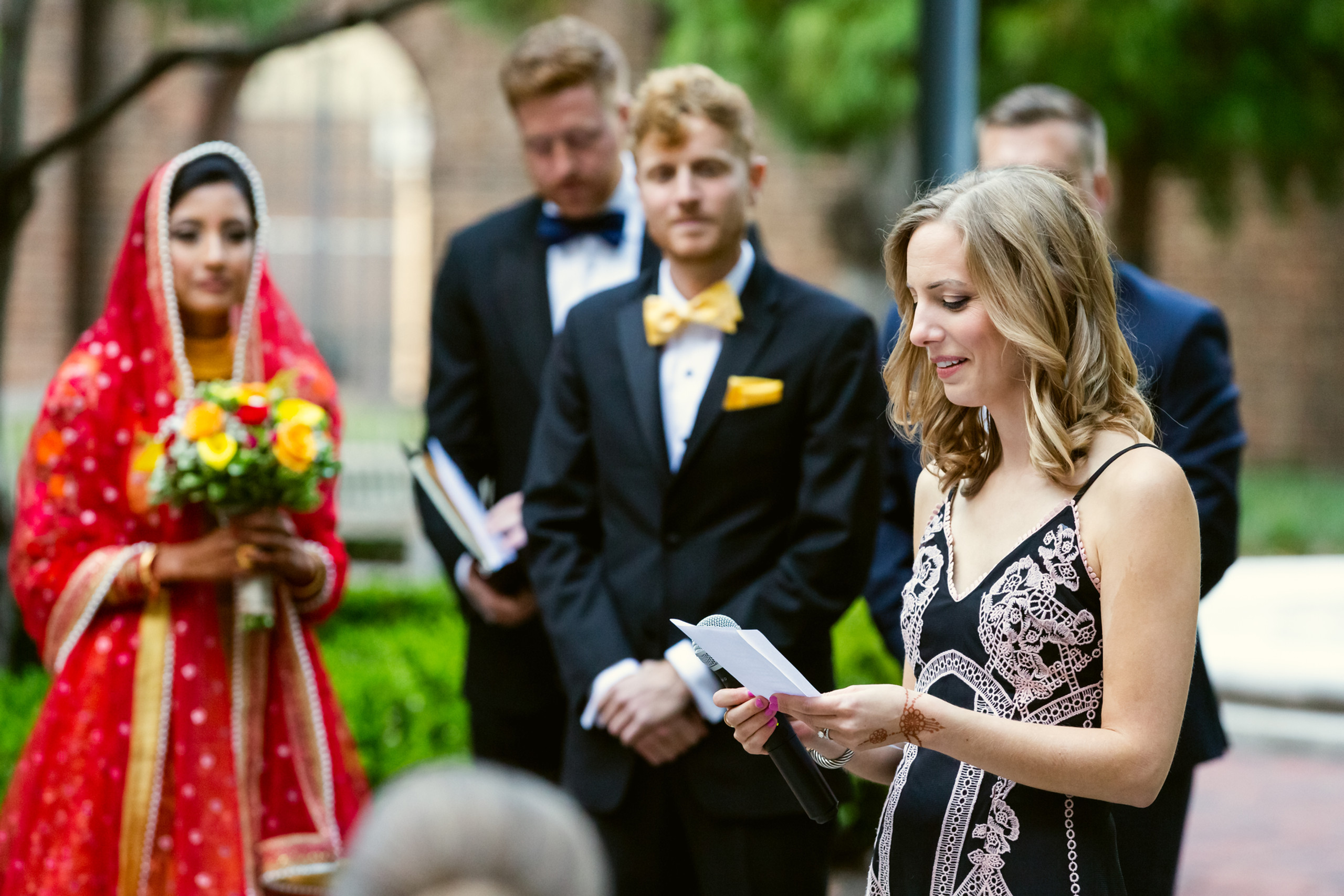 The groom's sister reads a passage during the wedding ceremony at the Penn Museum in Philadelphia, Pennsylvania.