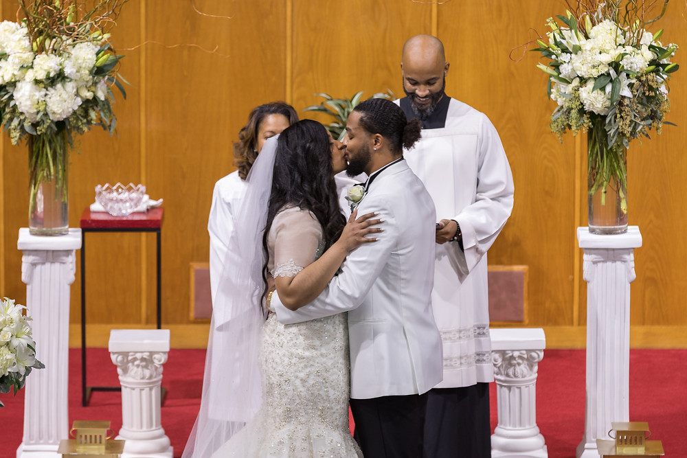 The bride and groom share their first kiss as Mr. and Mrs. during the wedding ceremony at the Alfred Street Baptist Church in Alexandria, Virginia.