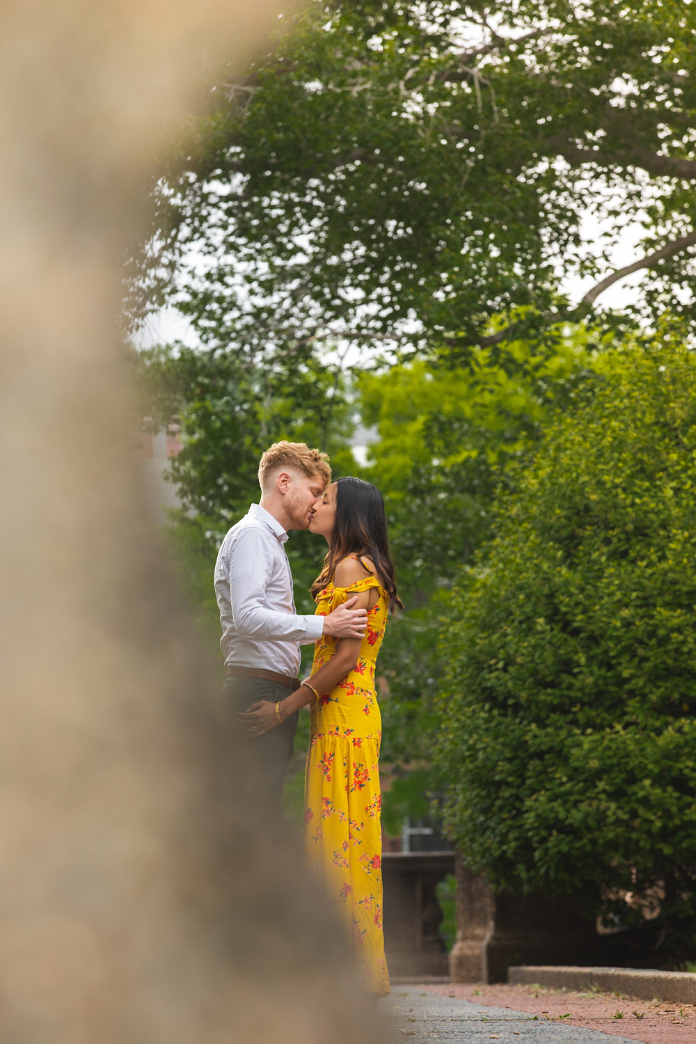 John and UK kiss during their engagement session at Meridian Hill Park in Washington DC.