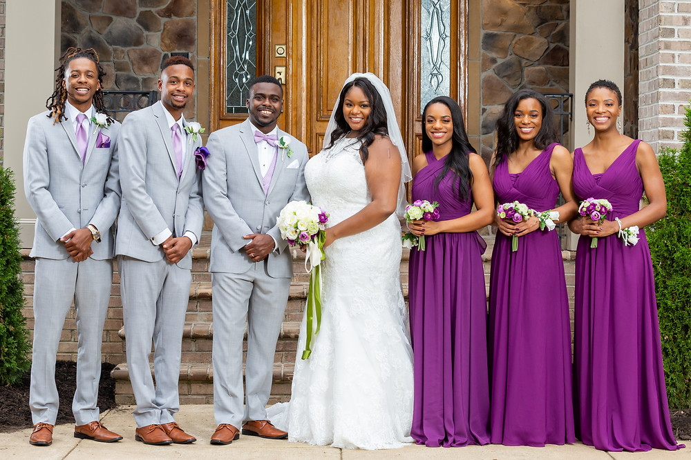 John and Jordyn pose for a formal portrait with their wedding party after the ceremony in Fairfax, Virginia.