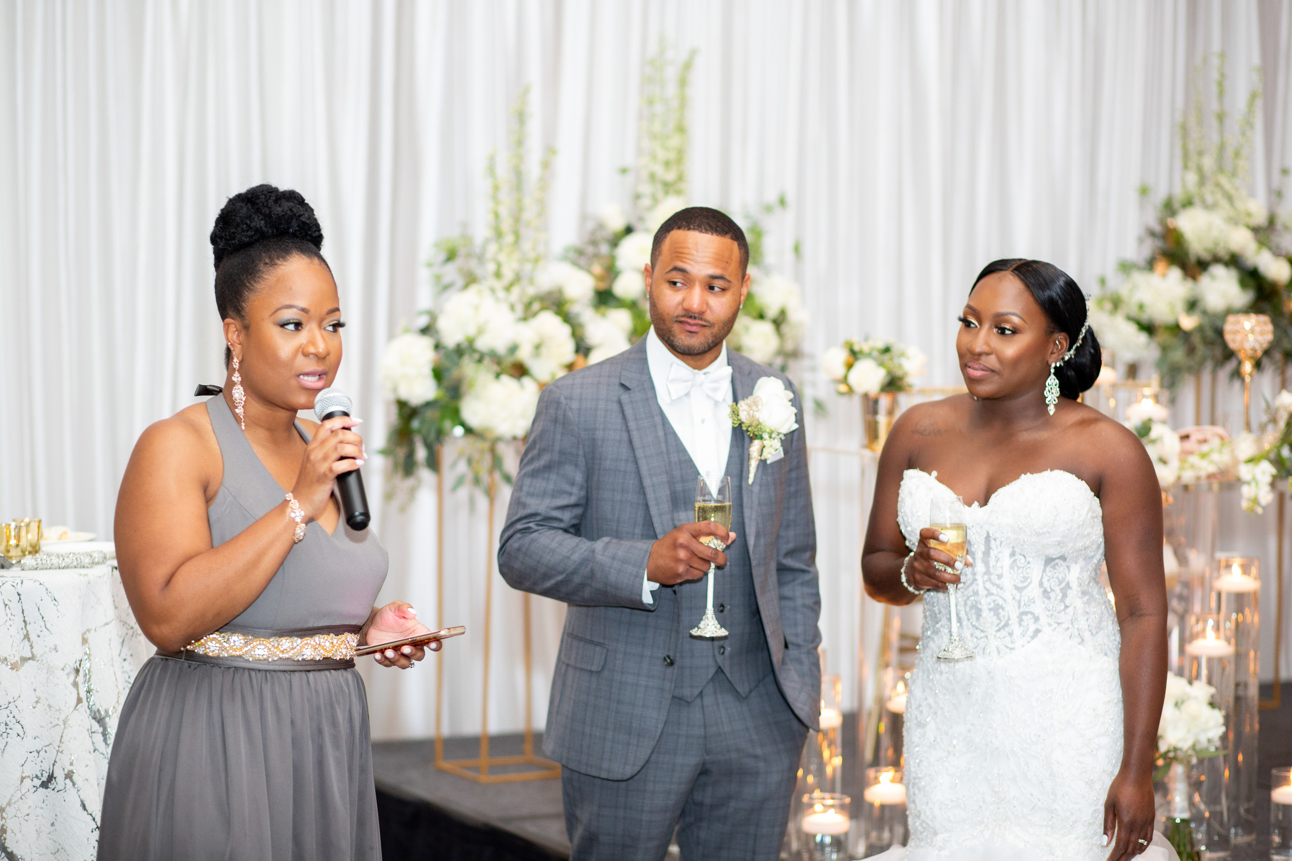 The maid of honor gives her speech and toasts the new couple during the wedding reception at the Hilton Main in Norfolk, Virginia.