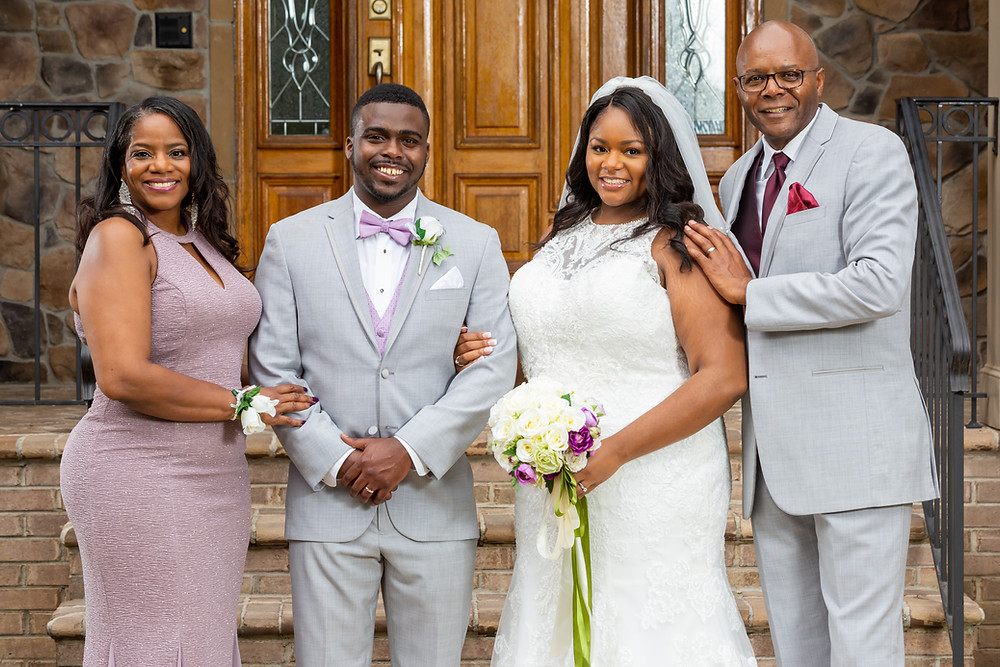 Jordyn and John pose with the parents of the bride for a wedding portrait after the ceremony in Fairfax, Virginia.