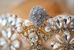 Bride's wedding ring sitting on the bride's garter belt before a wedding ceremony.