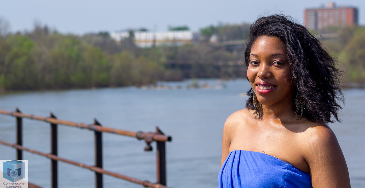 Beatrice poses for a portrait during her Graduation session at Brown's Island in Richmond, VA.