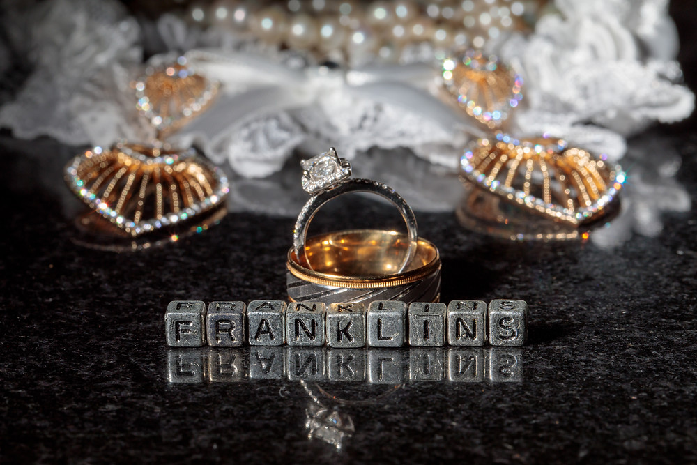 The engagement ring and wedding bands along with the bride's wedding accessories.