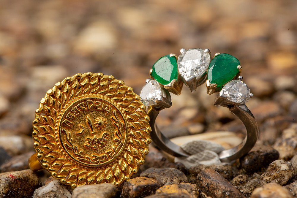 UK's emerald and diamond engagement ring during the engagement session at Meridian Hill Park in Washington DC.