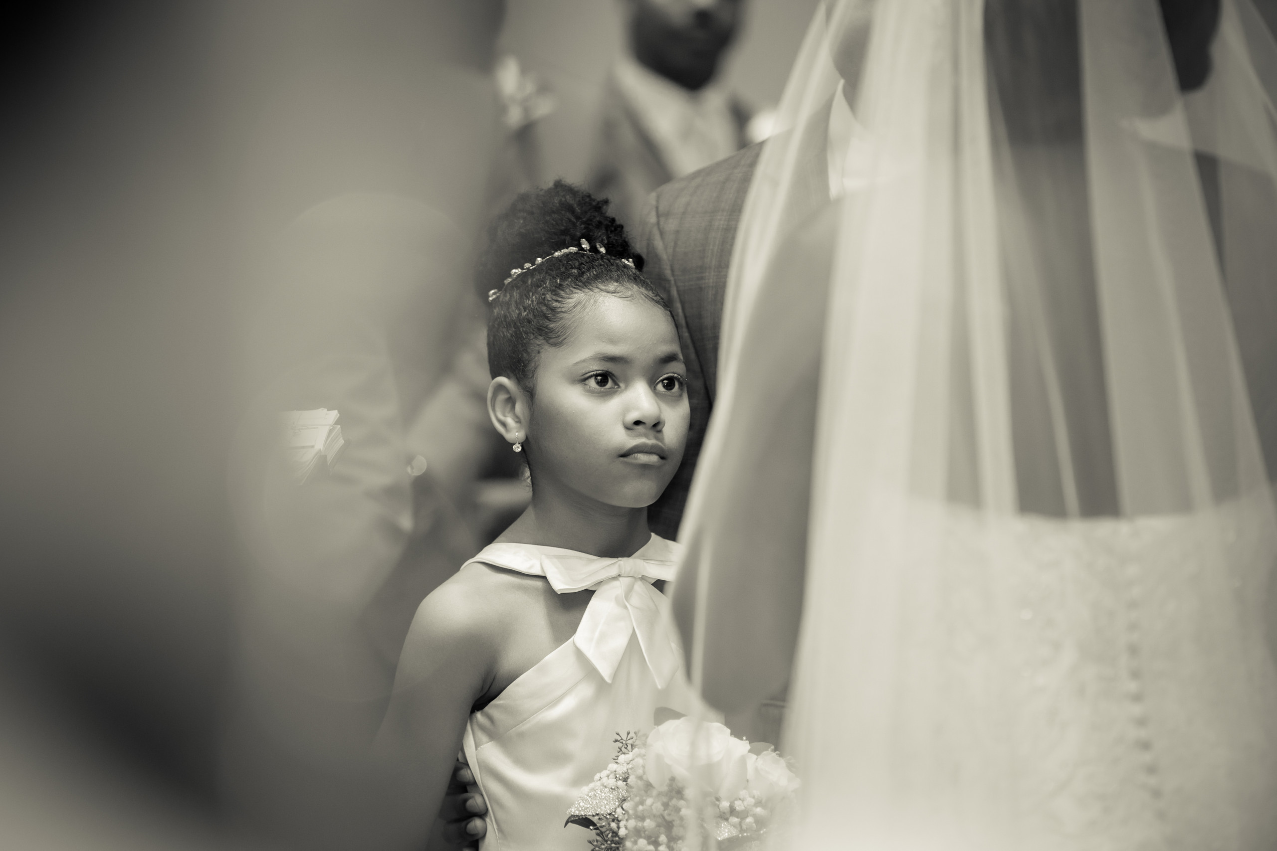 The bride recites vows to the groom's daughter during the wedding ceremony at the Hilton Main in Norfolk, Virginia.