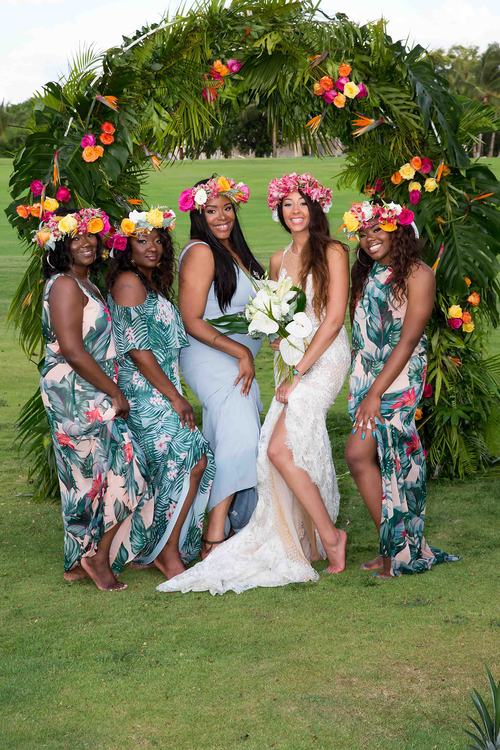 The bride and her bridesmaids pose for a fun formal portrait after the destination wedding in Punta Cana, Dominican Republic.
