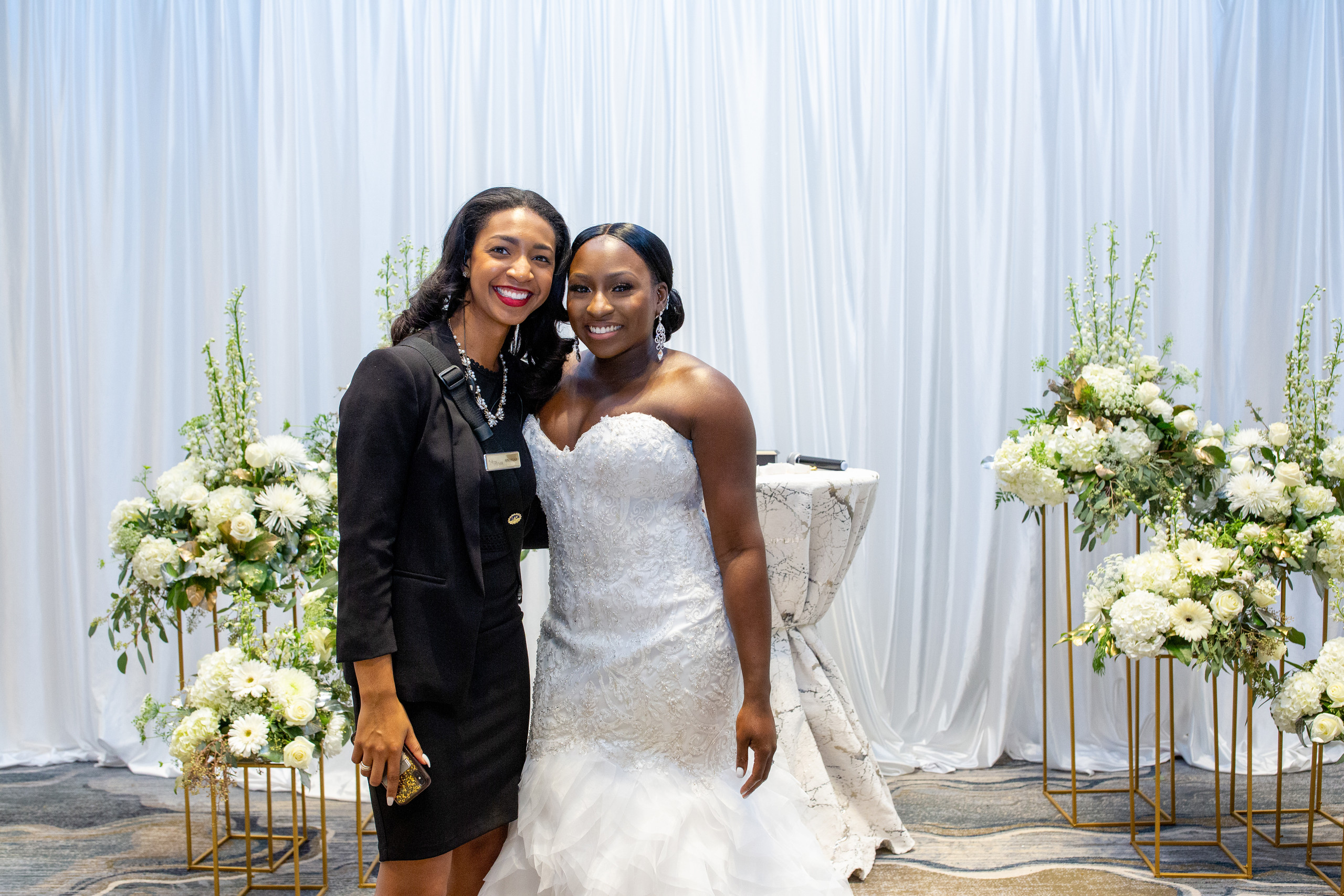 The bride poses with Andrias of Andrias Events during the Ceremony area reveal before the wedding ceremony at the Hilton Main in Norfolk, Virginia.