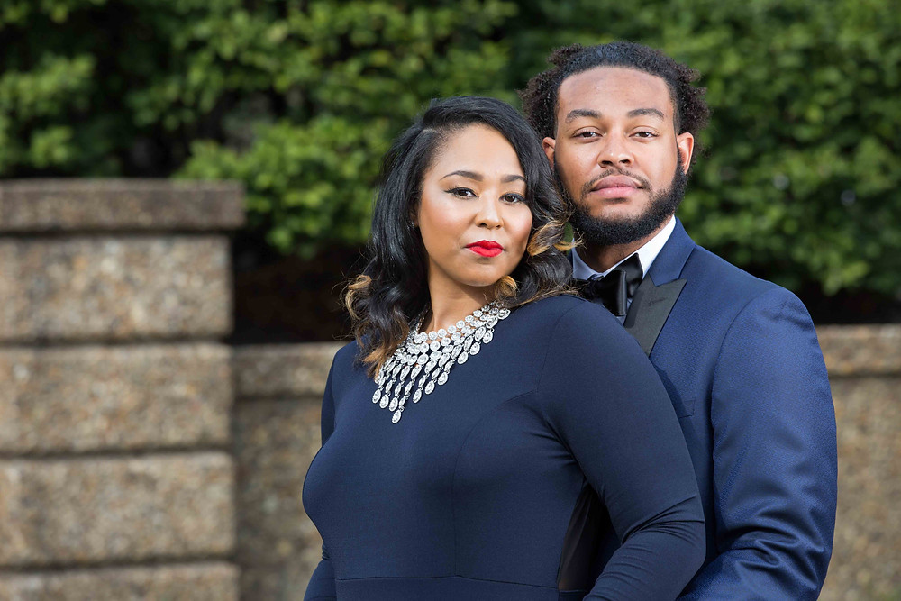 Carol and Shelton pose for a portrait during their engagement session in Meridian Hill Park.