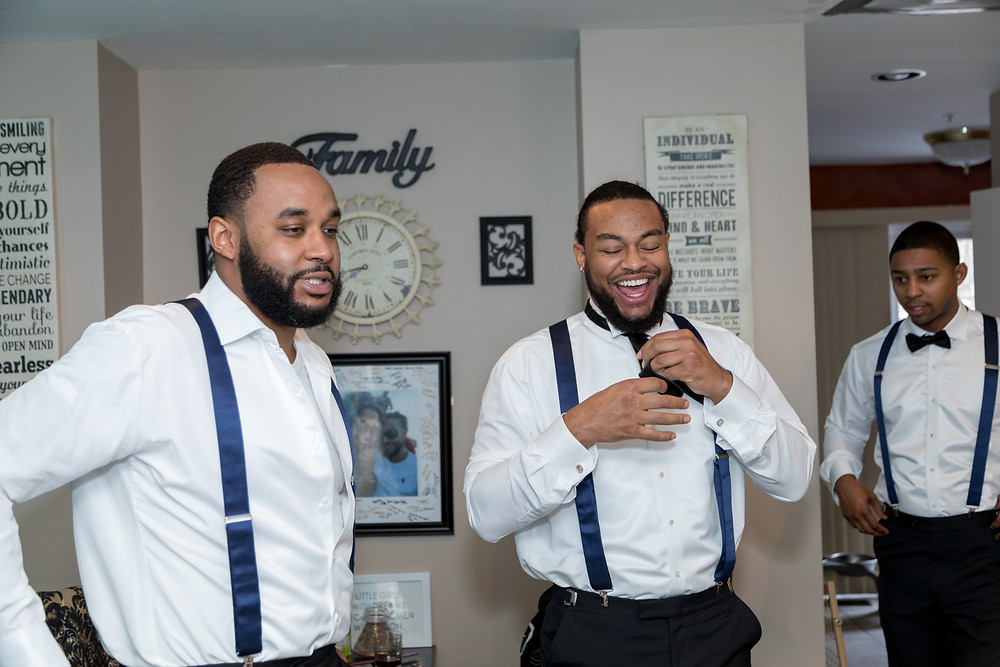 The groom and groomsmen sharing laughs in their formalwear from Tuxedo by Sarno in Washington DC.