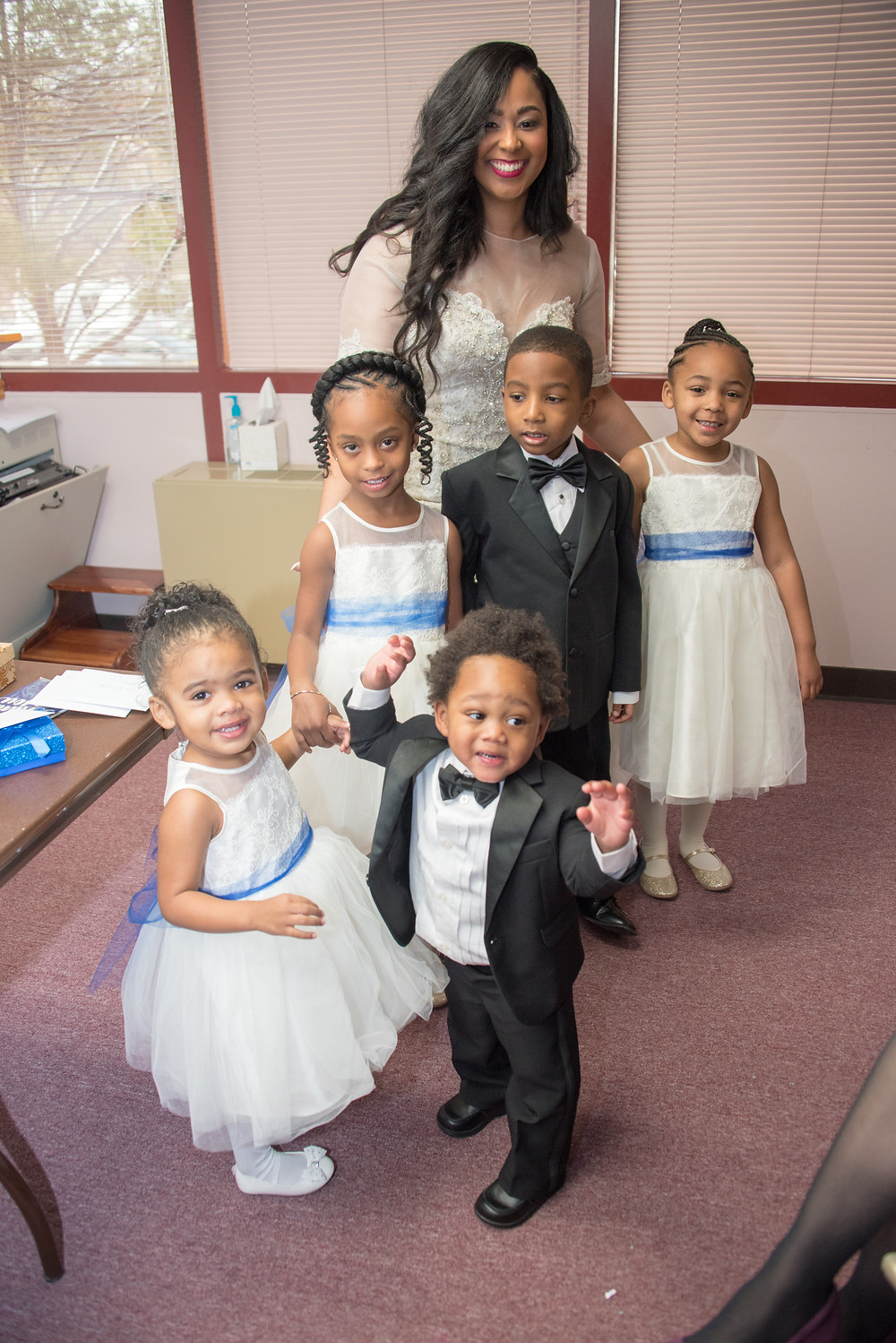 The bride poses with all of the children of the wedding before the ceremony at the Alfred Street Baptist Church in Alexandria VA.