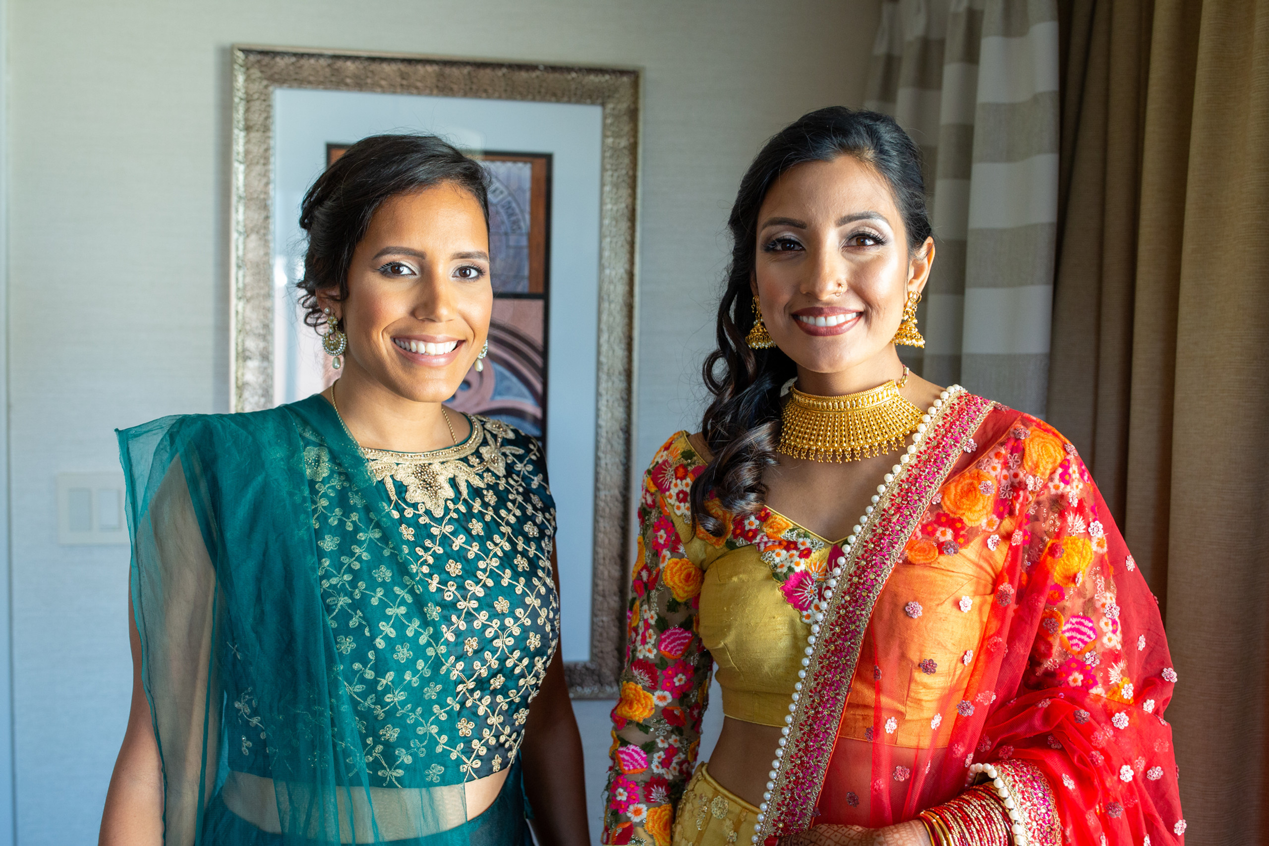 Bride and her sister pose in their traditional Nepali dresses before the wedding ceremony at the Penn Museum in Philadelphia, Pennsylvania.