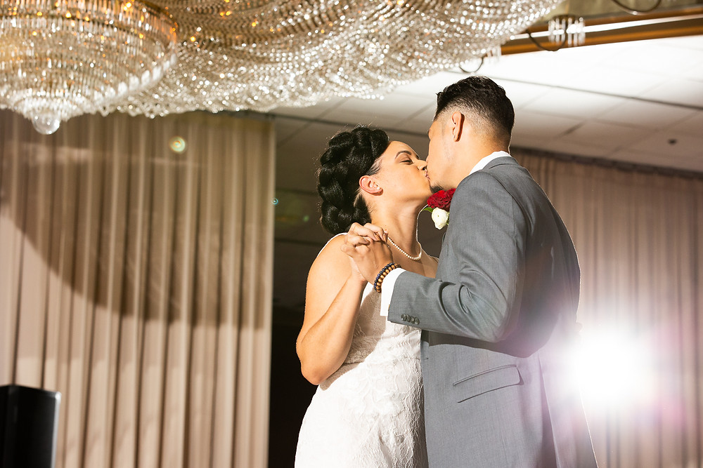 Bride and groom finish their first dance off with a kiss during the wedding reception at Martin's Crosswinds in Greenbelt, Maryland.