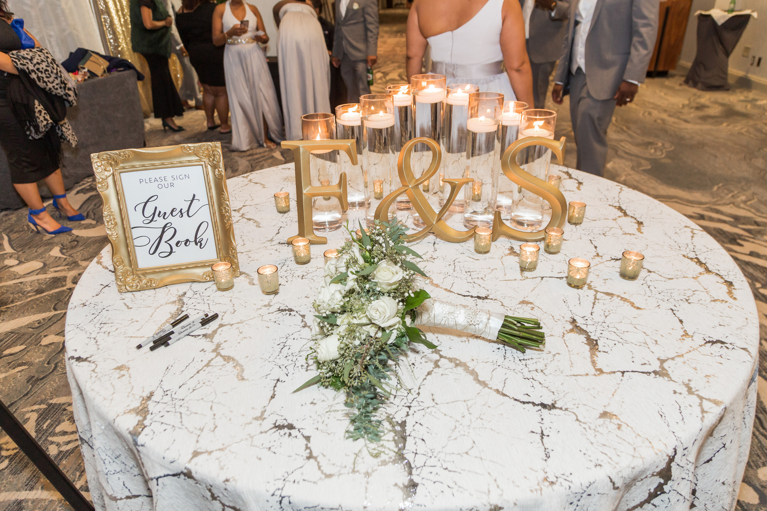 The marble and gold themed welcome table during the wedding reception at the Hilton Main in Norfolk, Virginia.