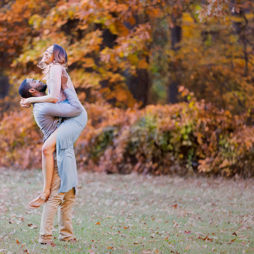 Briana and James pose for a photo for their engagement session at Rock Creek Park in Washington DC.