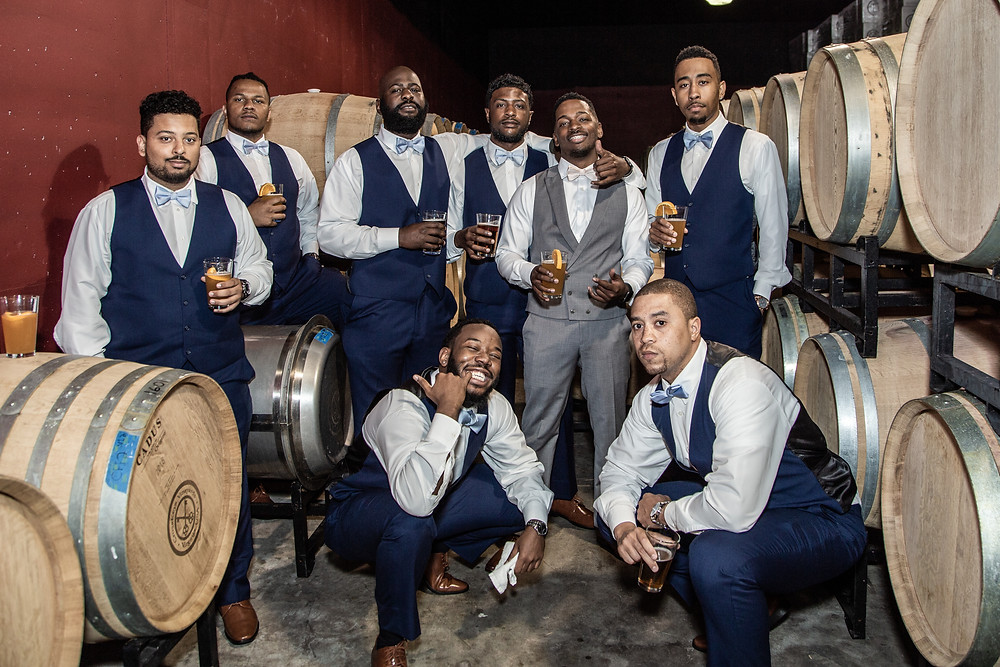 The groomsmen pose in a wine cellar before the wedding ceremony at Crosskeys Vineyards in Mt. Crawford, Virginia.