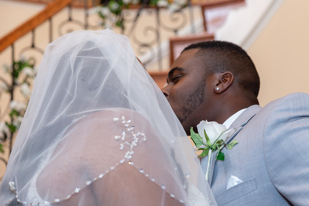 A close up photo of the first kiss of Jordyn and John during the wedding ceremony in Fairfax, Virginia.