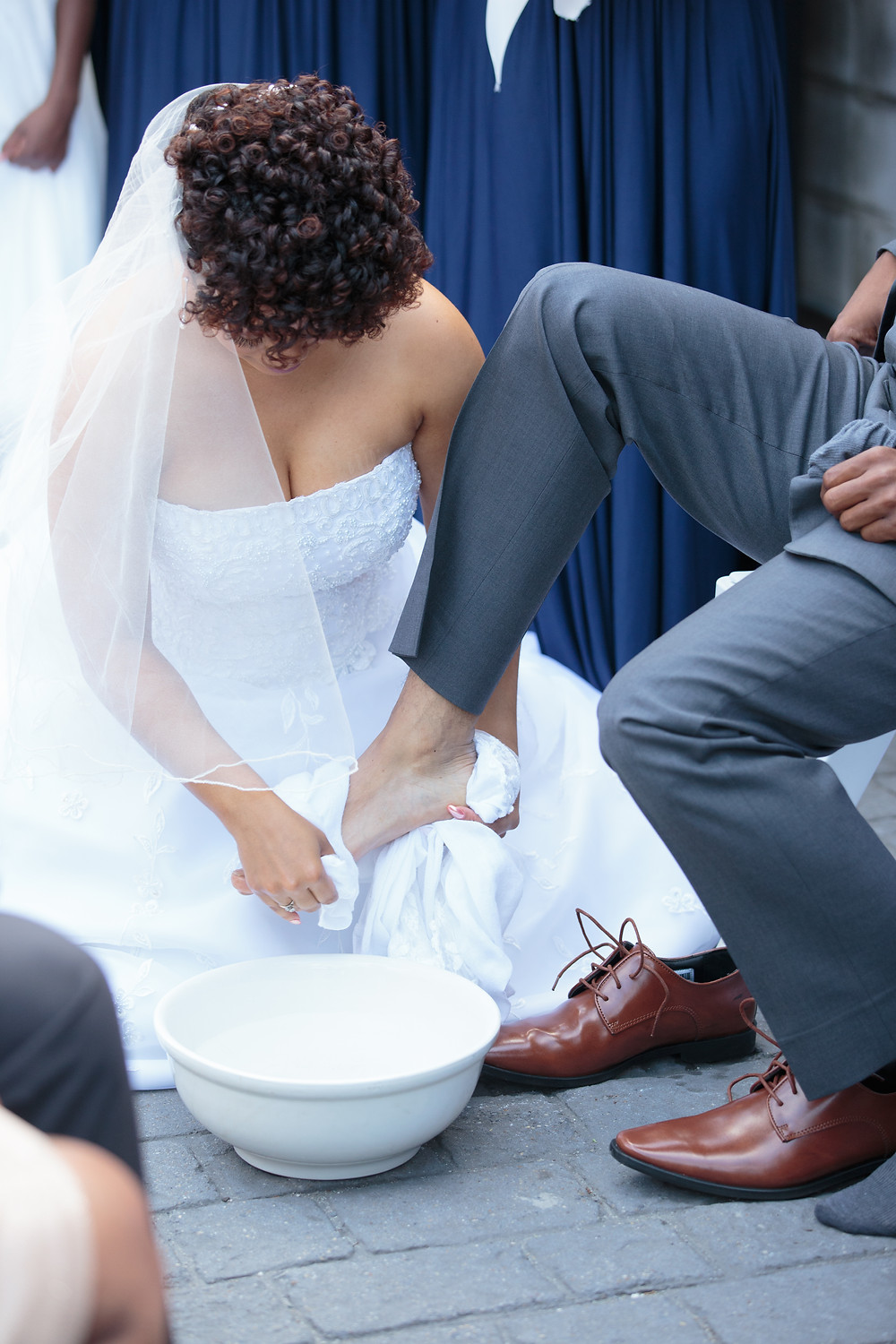 The bride and groom performing the feet washing tradition during the Sellers wedding ceremony at the Gallery O on H in Washington DC.