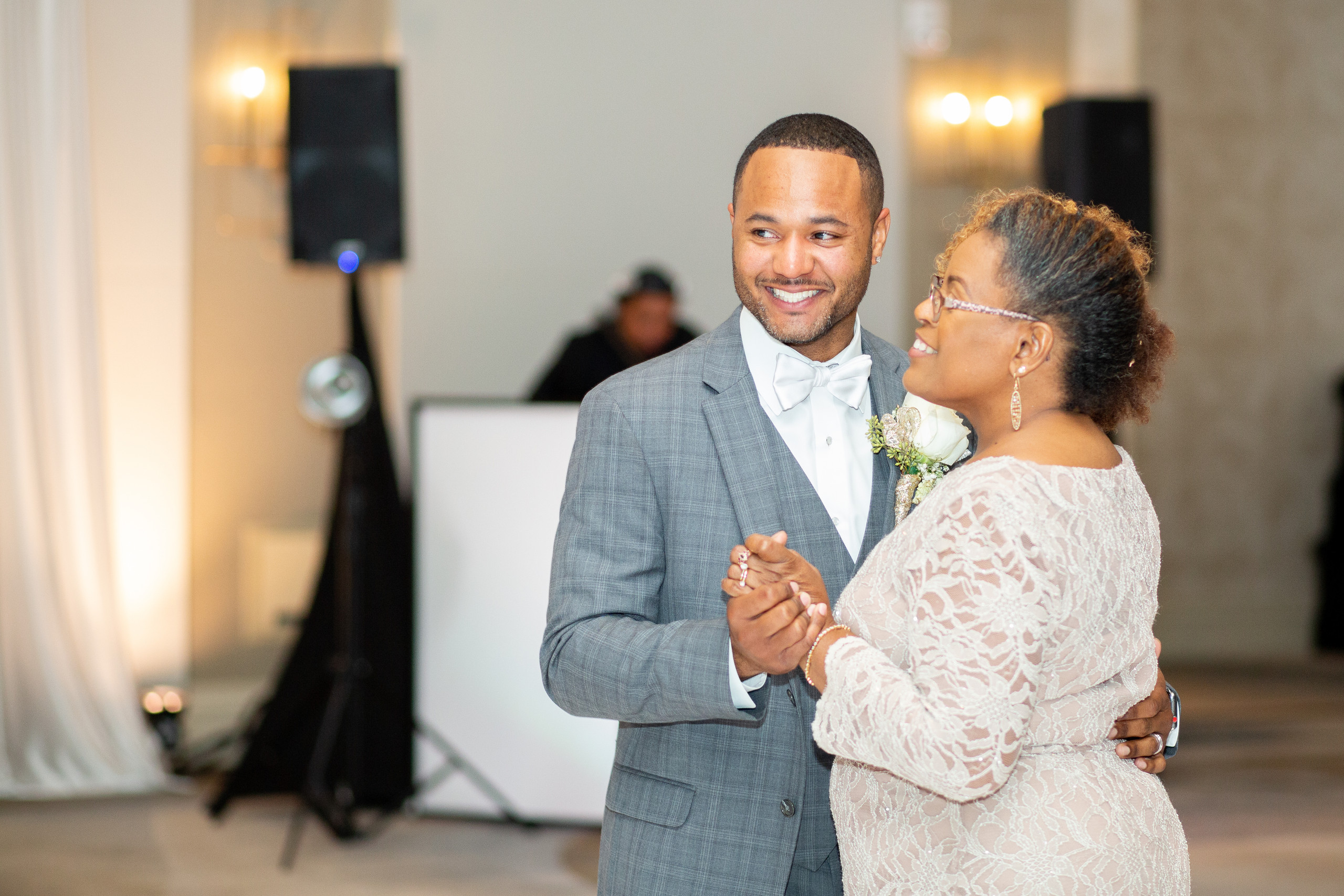 The groom and his mother dance during the wedding reception at the Hilton Main in Norfolk, Virginia.