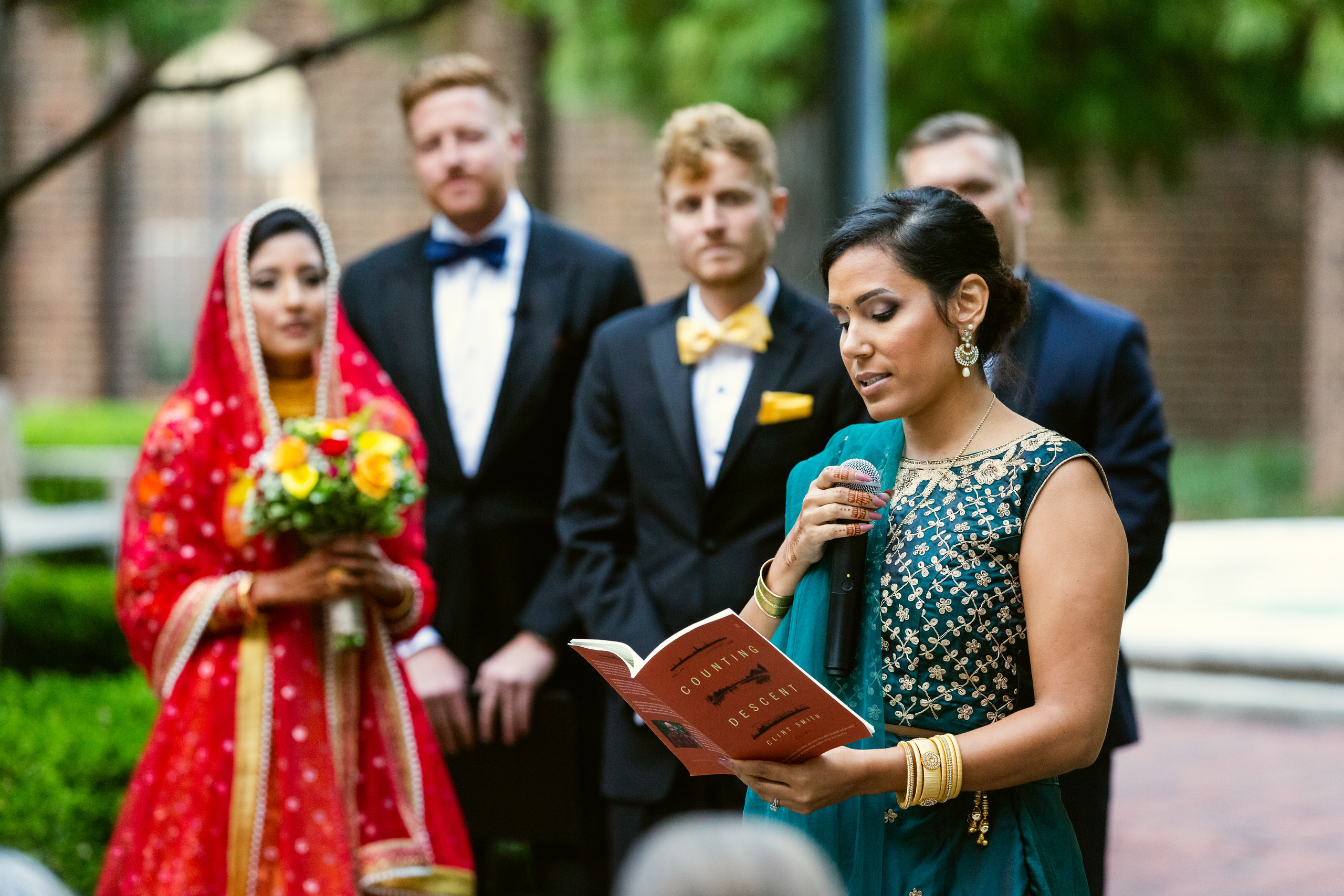 The bride's sister reads a poem during the wedding ceremony at the Penn Museum in Philadelphia, Pennsylvania.