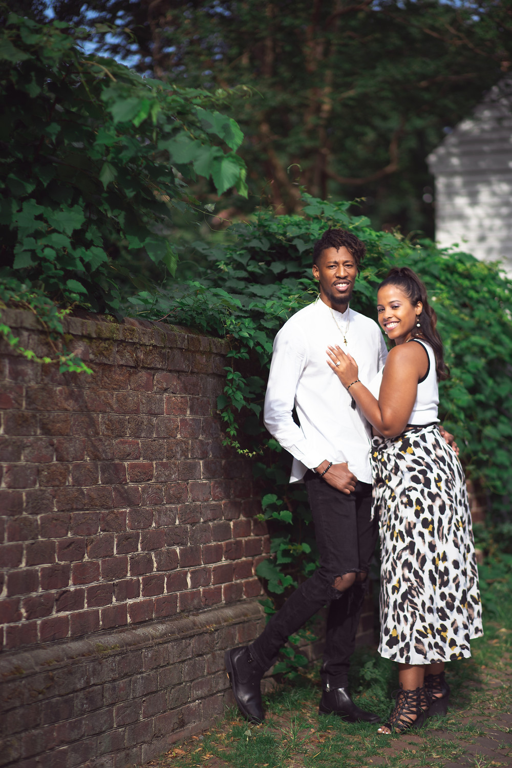 Couple posing for a portrait at their engagement session at The Carlyle House in Old Town Alexandria, Virginia.