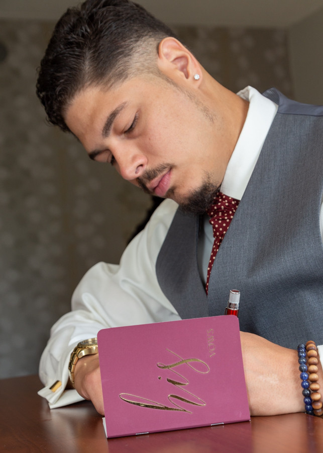 Groom handwriting his vows before the wedding ceremony at Martin's Crosswinds in Greenbelt, Maryland.