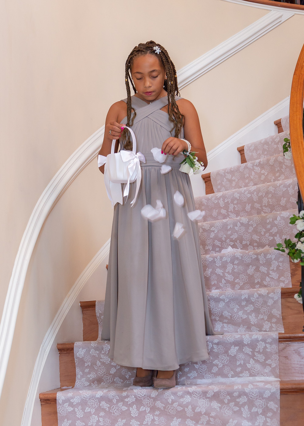 The flower girl preparing the isle runner before the bride enters the wedding ceremony in Fairfax, Virginia.