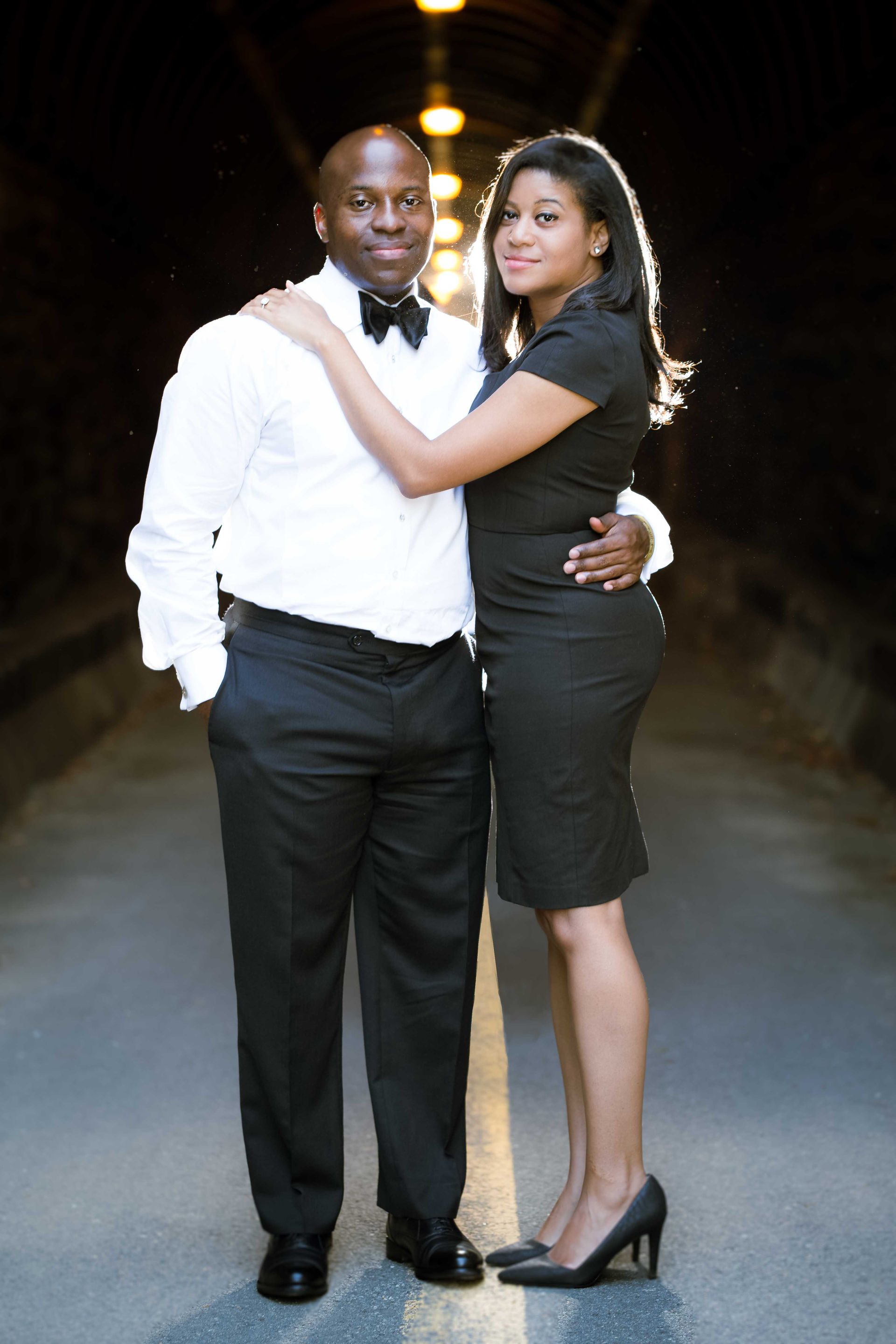 The couple posing during their engagement session in Old Town Alexandria, VA.