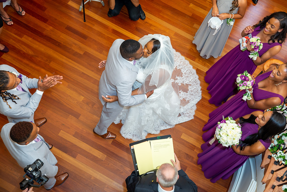 An overhead photo of Jordyn and John's first kiss during the wedding ceremony in Fairfax, Virginia.
