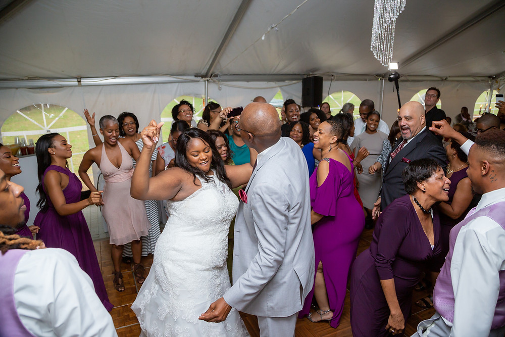 Jordyn dancing with her father and guests at the wedding reception in Fairfax, Virginia.