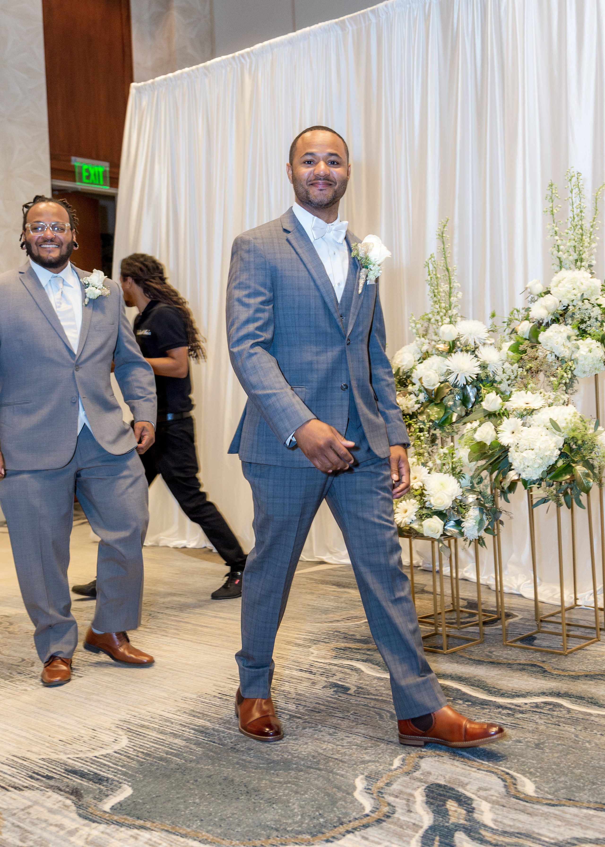 The groom walking to the alter with his best man during the wedding ceremony at the Hilton Main in Norfolk, Virginia.