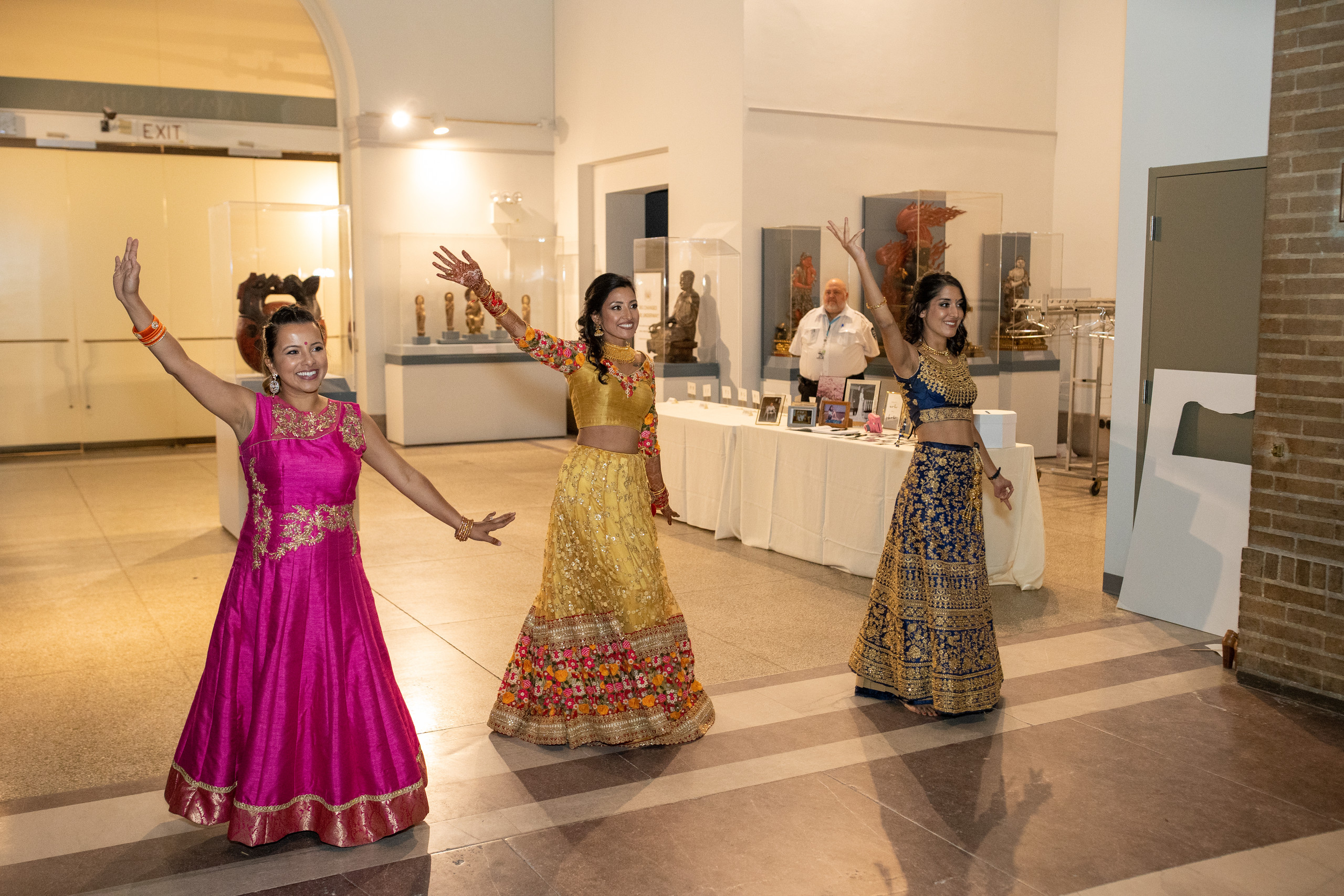 The bride, her sister and friend put on a special performance for the groom and guests during the wedding reception at the Penn Museum in Philadelphia, Pennsylvania.