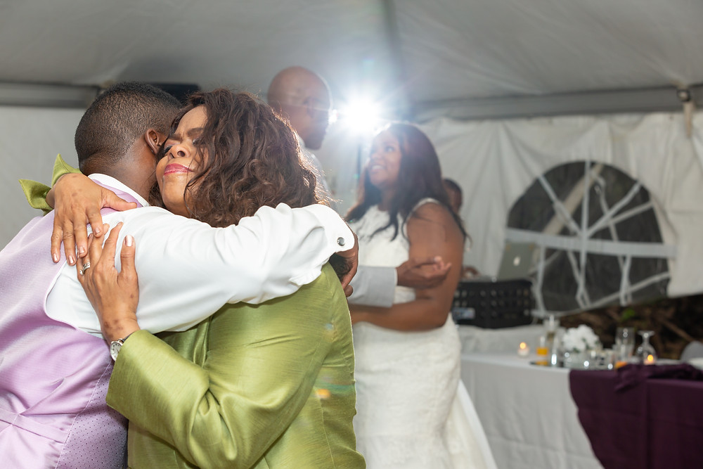 Mother and Son join Father and Daughter for a special dance on the dancefloor during the wedding reception in Fairfax, Virginia.