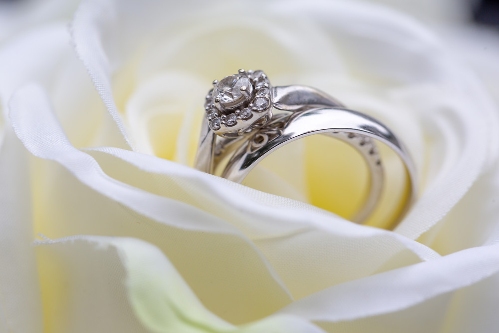 The bride's wedding band in her bouquet during the wedding reception in Fairfax, Virginia.