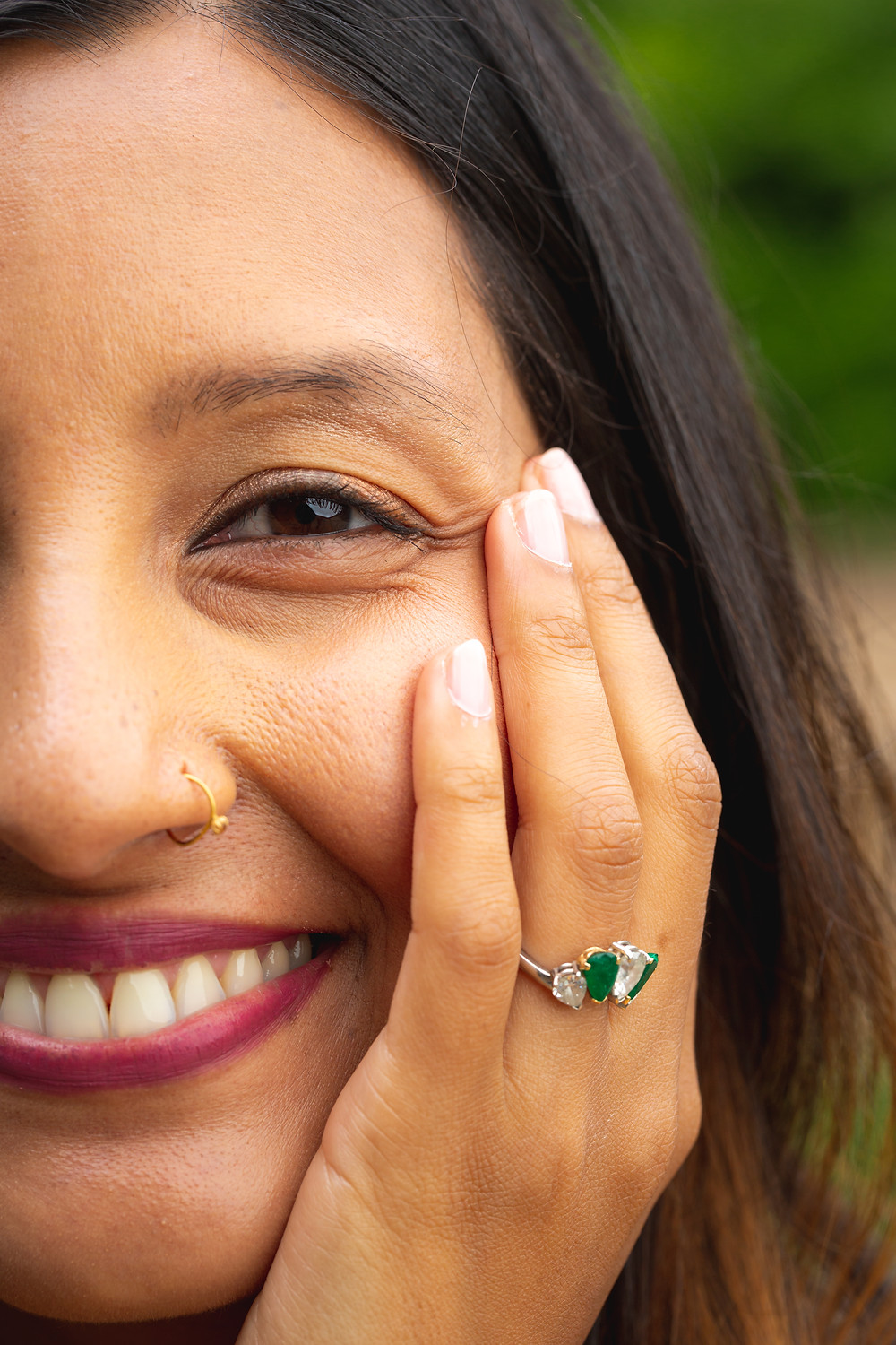UK shows off her smile and her engagement ring during the engagement session at Meridian Hill Park in Washington DC.