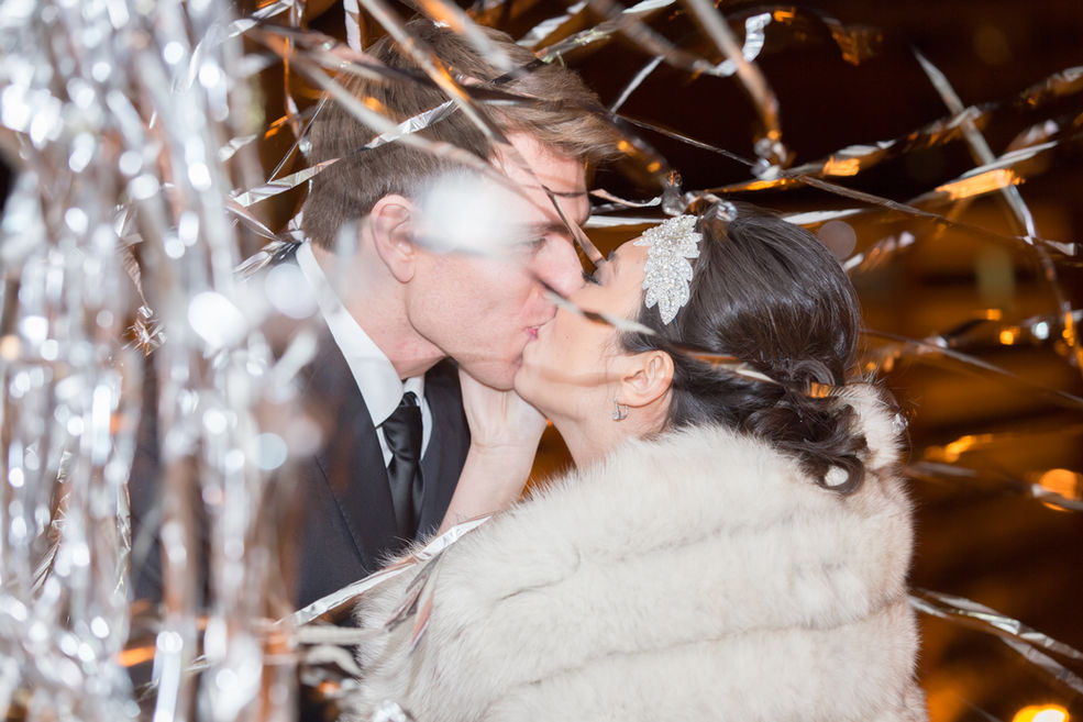 Bride and Groom first kiss at New Years'.