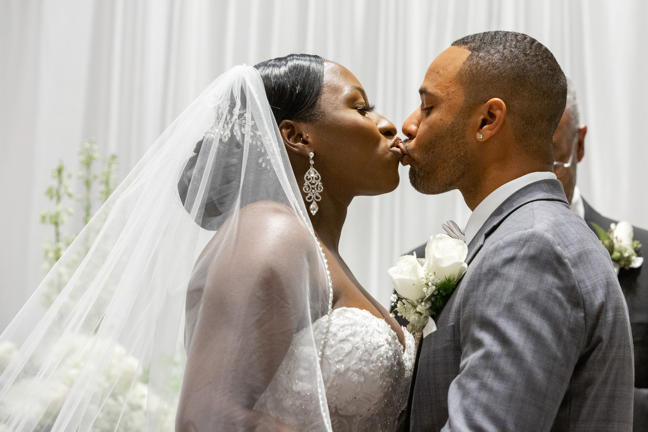 The bride and groom share their first kiss as husband and wife during the wedding ceremony at the Hilton Main in Norfolk, Virginia.