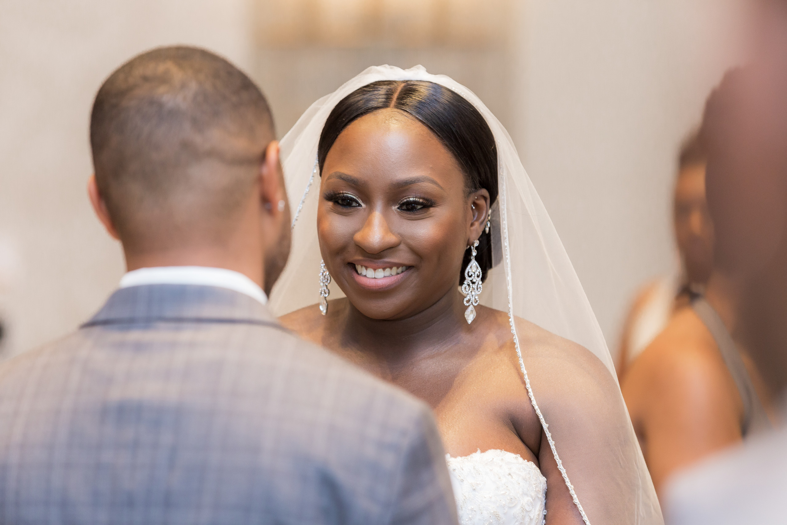 The bride gazing into her groom's eyes at the alter during the wedding ceremony at the Hilton Main in Norfolk, Virginia.