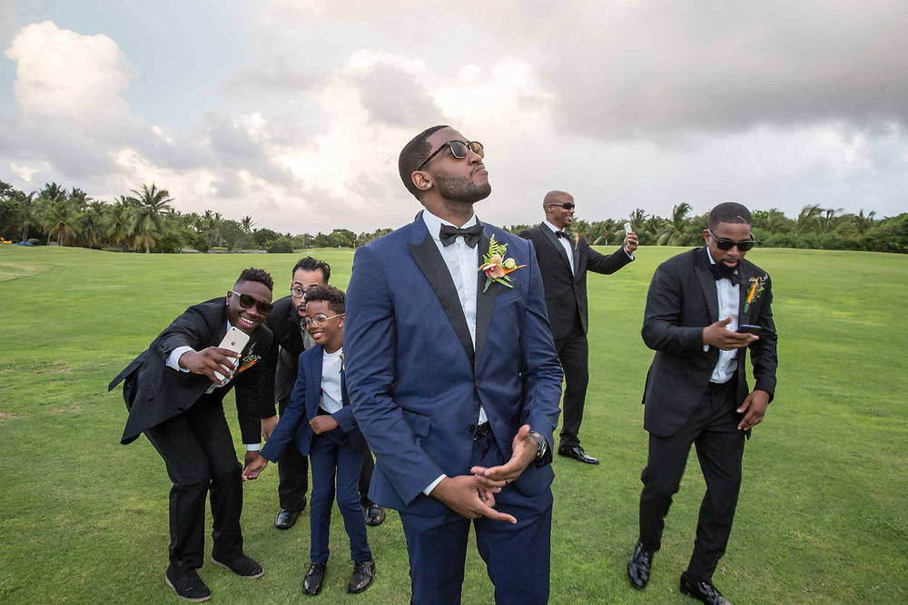 The groom and his groomsmen pose for a fun portrait after the destination wedding at Punta Cana, Dominican Republic.