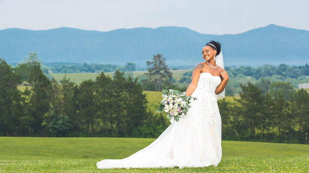 The bride posing for a portrait at Crosskeys Vineyards in Mt. Crawford, Virginia.