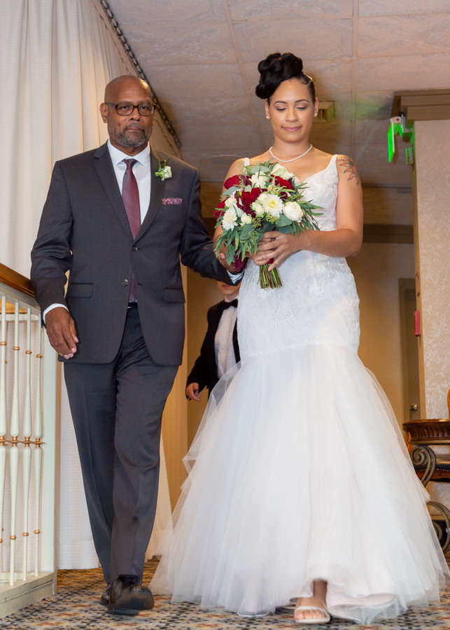 Bride and her father preparing to enter the wedding ceremony at Martin's Crosswinds in Greenbelt, Maryland.