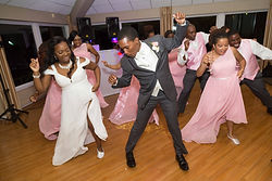 Bride and groom dancing with their wedding party during their wedding reception in Chesterfield, Virginia.