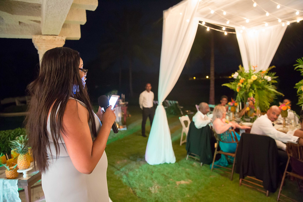 The maid of honor giving her poetic speech during the destination wedding reception in Punta Cana, Dominican Republic.