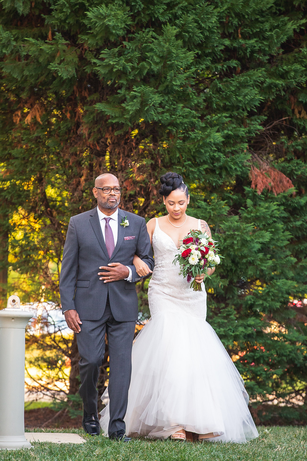 Bride and her father walking into the wedding ceremony area at Martin's Crosswinds in Greenbelt, Maryland.