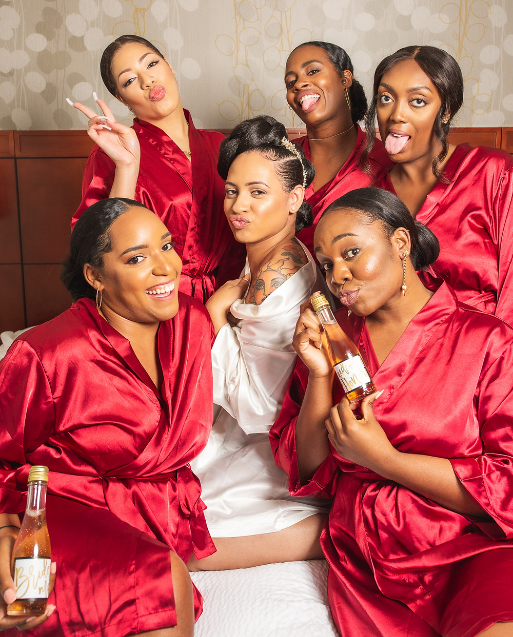 Bride and bridesmaids in robes before the wedding at Martin's Crosswinds in Greenbelt, Maryland